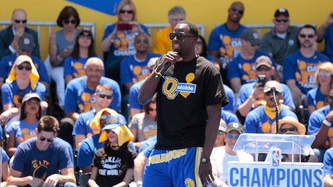 OAKLAND, CA - JUNE 15:  Draymond Green #23 of the Golden State Warriors celebrates winning the 2017 NBA Championship during a parade on June 15, 2017 in Oakland, CA.  NOTE TO USER: User expressly acknowledges and agrees that, by downloading and/or using this Photograph, user is consenting to the terms and conditions of the Getty Images License Agreement. Mandatory Copyright Notice: Copyright 2017 NBAE (Photo by Jack Arent/NBAE via Getty Images)