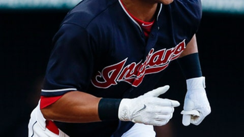 Cleveland Indians' Michael Brantley watches his solo home run off Los Angeles Angels starting pitcher Jesse Chavez during the second inning in a baseball game, Tuesday, July 25, 2017, in Cleveland. (AP Photo/Ron Schwane)
