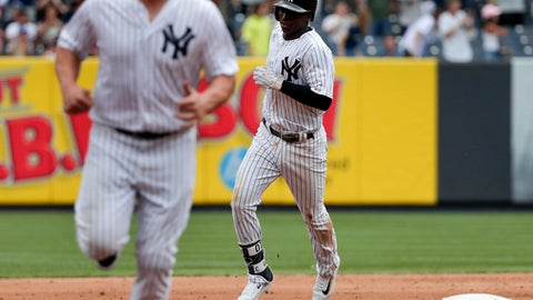 New York Yankees' Didi Gregorius, right, and designated hitter Matt Holliday round the bases after Gregorius hit a two-run home run against the Cincinnati Reds during the seventh inning of a baseball game, Wednesday, July 26, 2017, in New York. (AP Photo/Julie Jacobson)