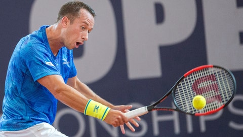 Germany's Philipp Kohlschreiber returns a shot to Germany's  Florian Mayer during the men's single semifinal match at the Tennis ATP-Tour German Open in Hamburg, Germany,  Saturday, July 29, 2017.  (Daniel Bockwoldt/dpa via AP)
