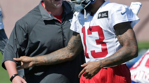 New York Giants head coach Ben McAdoo, left, talks with Odell Beckham, Jr. during a NFL football training camp in East Rutherford, N.J., Sunday, July 30, 2017. (AP Photo/Seth Wenig)