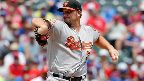 Baltimore Orioles starting pitcher Wade Miley throws to the Texas Rangers in the first inning of a baseball game, Sunday, July 30, 2017, in Arlington, Texas. (AP Photo/Tony Gutierrez)