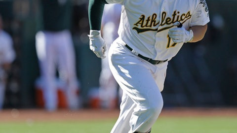Oakland Athletics' Yonder Alonso runs the bases after hitting a winning home run in the twelfth inning of a baseball game against the Minnesota Twins, Sunday, July 30, 2017, in Oakland, Calif. (AP Photo/Ben Margot)