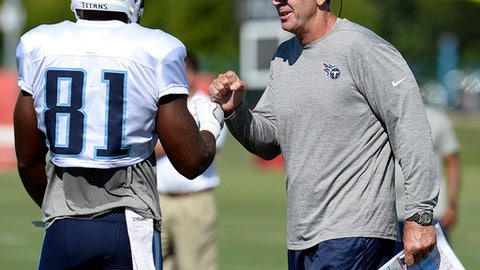 Tennessee Titans head coach Mike Mularkey fist bumps tight end Jonnu Smith (81) after Smith caught a pass during NFL football training camp Monday, July 31, 2017, in Nashville, Tenn. (AP Photo/Mark Zaleski)