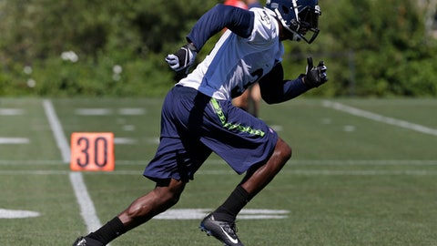 Seattle Seahawks strong safety Kam Chancellor runs during an NFL football training camp, Monday, July 31, 2017, in Renton, Wash. (AP Photo/Ted S. Warren)