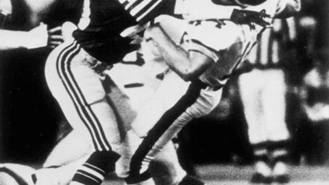 FILE - In this Dec. 6, 1981, file photo, Seattle Seahawks safety Kenny Easley (45) knocks New York Jets quarterback Richard Todd (14) to the ground during the first half of an NFL football game in Seattle. Easley is to to inducted Saturday at the Pro Football Hall of Fame. (AP Photo/File)