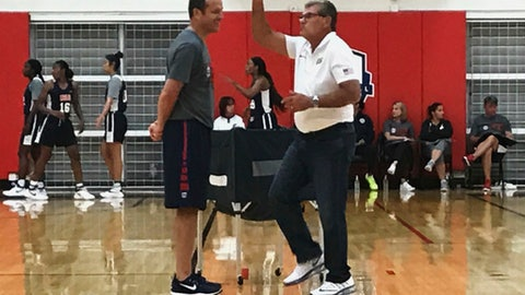 Connecticut head coach Geno Auriemma, right, and Louisville head coach Jeff Walz talk during an Under-23 training camp in Colorado Springs, Colo., Monday, July 31, 2017. Walz is the head coach of the team. With the start of the college basketball season two months away, USA Basketball held the inaugural Under-23 training camp with 35 of the best college players. (AP Photo/Doug Feinberg)