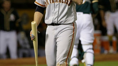 San Francisco Giants' Buster Posey reacts after striking out against the Oakland Athletics during the seventh inning of a baseball game in Oakland, Calif., Monday, July 31, 2017. The Athletics won 8-5. (AP Photo/Jeff Chiu)