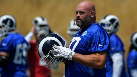 FILE - In this May 30, 2017, file photo, Los Angeles Rams tackle Andrew Whitworth stands on the field during NFL football practice, in Thousand Oaks, Calif. Although the left tackle is four years older than his new head coach, he couldn't resist the challenge and adventure of helping to rebuild the NFL's worst offense on the West Coast. (AP Photo/Mark J. Terrill, File)