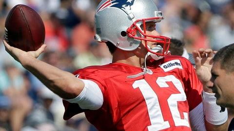 New England Patriots quarterback Tom Brady (12)  passes at NFL football training camp, Tuesday, Aug. 1, 2017, in Foxborough, Mass. (AP Photo/Steven Senne)