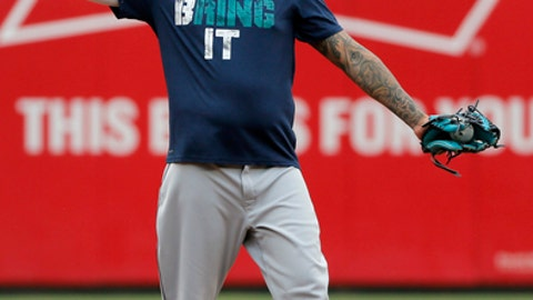 Seattle Mariners' Felix Hernandez tosses a ball from the infield during batting practice before the team's baseball game against the Texas Rangers on Tuesday, Aug. 1, 2017, in Arlington, Texas. (AP Photo/Tony Gutierrez)