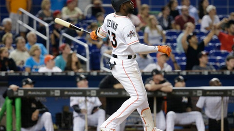 Miami Marlins' Marcell Ozuna watches his three-run home run during the fifth inning against the Washington Nationals in a baseball game, Tuesday, Aug. 1, 2017, in Miami. (AP Photo/Lynne Sladky)