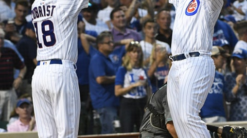 Chicago Cubs' Anthony Rizzo, right, high fives Ben Zobrist (18) after they score on his two-run home run during the second inning of a baseball game against the Arizona Diamondbacks on Tuesday, Aug. 1, 2017, in Chicago. (AP Photo/Matt Marton)