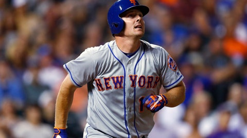 New York Mets' Jay Bruce watches his solo home run off Colorado Rockies relief pitcher Chris Rusin during the eighth inning of a baseball game Tuesday, Aug. 1, 2017, Denver. The Rockies won 5-4. (AP Photo/David Zalubowski)