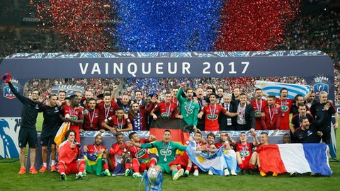 FILE - In this May 27, 2017 file photo, the Paris Saint-Germain's team celebrate with their trophy after winning the French Cup 2017 Final soccer match, between Paris Saint-Germain (PSG) and Angers at Stade de France in Saint Denis, north of Paris, France. PSG is aiming to win the league title this season after finishing behind Monaco  in the last campaign. (AP Photo/Francois Mori, File)