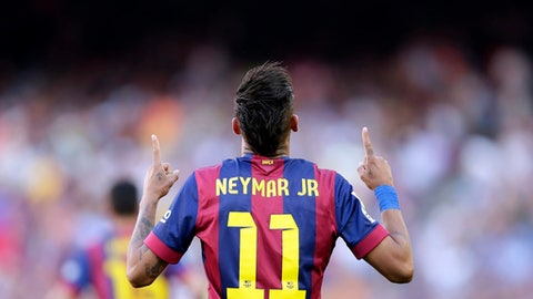 FILE- In this Saturday, May 9, 2015 file photo, FC Barcelona's Neymar celebrates after scoring against Real Sociedad during a Spanish La Liga soccer match at the Camp Nou stadium in Barcelona, Spain. Barcelona said Wednesday, Aug. 2, 2017, Neymar's 222 million euro ($262 million) release clause must be paid in full if the Brazil striker wants to leave. (AP Photo/Manu Fernandez, File)