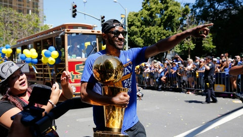 OAKLAND, CA - JUNE 15:  Ian Clark #21 of the Golden State Warriors walks down the street with the Larry O'Brien Trophy during the Victory Parade and Rally on June 15, 2017 in Oakland, California at The Henry J. Kaiser Convention. NOTE TO USER: User expressly acknowledges and agrees that, by downloading and or using this photograph, User is consenting to the terms and conditions of the Getty Images License Agreement. Mandatory Copyright Notice: Copyright 2017 NBAE (Photo by Rey Josue/NBAE via Getty Images)