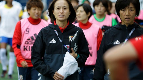 FILE - In this Thursday, July 27, 2017 file photo, Japan coach Asako Takakura, center, walks to the bench with her reserve players before a Tournament of Nations women's soccer match against Brazil in Seattle. An ongoing shift in women's soccer has been apparent at the Tournament of Nations _ not on field but on the sidelines. (AP Photo/Ted S. Warren, File)