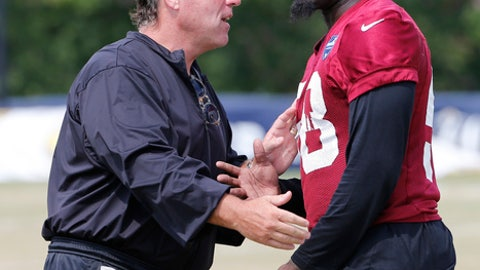 Washington Redskin defensive line coach, Jim Tomsula, talks with linebacker Junior Galette (58) during practice at NFL football training camp in Richmond, Va., Wednesday, Aug. 2, 2017. (AP Photo/Steve Helber)