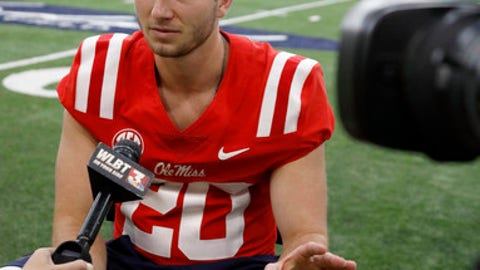 Mississippi quarterback Shea Patterson (20) answers a reporter's question during Mississippi's media day, Wednesday, Aug. 2, 2017, in Oxford, Miss. Mississippi opens its preseason camp after a tumultuous offseason highlighted by the stunning resignation of coach Hugh Freeze last month. The Rebels still have some talent remaining on the roster, but it remains to be seen if the chaos and distractions have taken their toll. (AP Photo/Rogelio V. Solis)