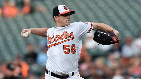 Baltimore Orioles pitcher Jeremy Hellickson delivers against the Kansas City Royals in the first inning of a baseball game, Wednesday, Aug. 2, 2017, in Baltimore. (AP Photo/Gail Burton)