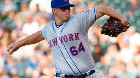 New York Mets starting pitcher Chris Flexen throws to the plate against the Colorado Rockies during the first inning of a baseball game Wednesday, Aug. 2, 2017, in Denver. (AP Photo/Jack Dempsey)