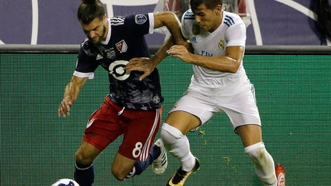 MLS All-Stars' Graham Zusi, left, controls the ball against Real Madrid's Theo Hernandez during the first half of the MLS All-Star Game, Wednesday, Aug. 2, 2017, in Chicago. (AP Photo/Nam Y. Huh)