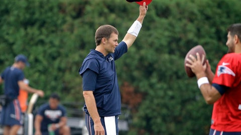"""New England Patriots' Tom Brady removes his hat as a crowd of spectators sings """"Happy Birthday"""" to the quarterback at NFL football training camp, Thursday, Aug. 3, 2017, in Foxborough, Mass. Brady turned 40-years-old Thursday. (AP Photo/Steven Senne)"""