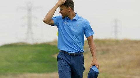 Golden State Warriors NBA basketball player Stephen Curry scratches his head after finishing the first round on the ninth green during the Web.com Tour's Ellie Mae Classic golf tournament Thursday, Aug. 3, 2017, in Hayward, Calif. Curry shot a 4-over-par 74. (AP Photo/Eric Risberg)