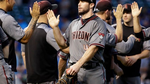 Arizona Diamondbacks' Paul Goldschmidt celebrates with teammates after the Diamondbacks defeated the Chicago Cubs 10-8 in a baseball game Thursday, Aug. 3, 2017, in Chicago. (AP Photo/Nam Y. Huh)
