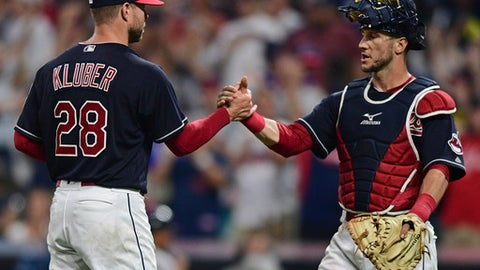 Cleveland Indians starting pitcher Corey Kluber and Yan Gomes, right, celebrate after they defeated the New York Yankees 5-1 in a baseball game, Thursday, Aug. 3, 2017, in Cleveland. (AP Photo/David Dermer)