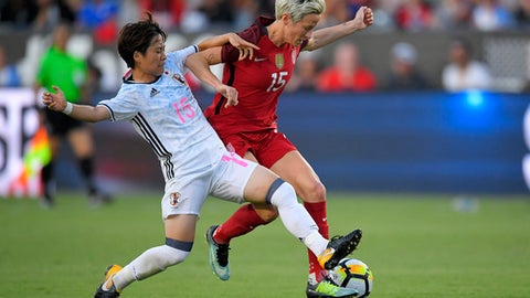 Japan's Yuka Momiki, left, and United States' Megan Rapinoe vie for the ball during the first half of Tournament of Nations soccer match, Thursday, Aug. 3, 2017, in Carson, Calif. (AP Photo/Mark J. Terrill)