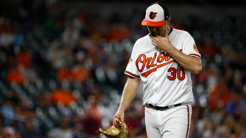 Baltimore Orioles starting pitcher Chris Tillman walks off the field after being removed during the third inning of the team's baseball game against the Detroit Tigers in Baltimore, Thursday, Aug. 3, 2017. (AP Photo/Patrick Semansky)
