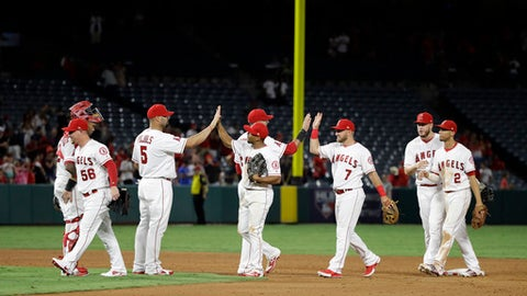 Los Angeles Angels celebrate the team's 5-4 win ocwe the Philadelphia Phillies in a baseball game, Thursday, Aug. 3, 2017, in Anaheim, Calif. (AP Photo/Jae C. Hong)