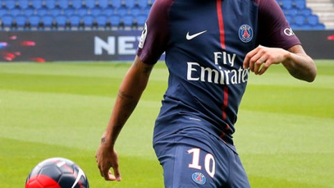 Brazilian soccer star Neymar controls the ball following a press conference in Paris Friday, Aug. 4, 2017. Neymar arrived in Paris on Friday the day after he became the most expensive player in soccer history when completing his blockbuster transfer to Paris Saint-Germain from Barcelona for 222 million euros ($262 million).(AP Photo/Michel Euler)