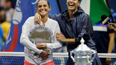 """FILE  - In this Saturday, Sept. 12, 2015 file photo Roberta Vinci, of Italy, left, and Flavia Pennetta, of Italy, react during the trophy ceremony for the women's championship match of the U.S. Open tennis tournament, in New York.  Former U.S. Open runner-up Roberta Vinci said her tennis trophies have been stolen, writing on Instagram, """"Unfortunately, a few days ago a group of thieves entered my house in Taranto and stole valuable objects. (AP Photo/David Goldman, File)"""