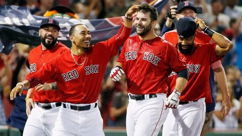 Boston Red Sox's Mitch Moreland, center right, celebrates his walkoff home run with teammates including Mookie Betts, second from left, during the 11th inning of a baseball game against the Chicago White Sox in Boston, Friday, Aug. 4, 2017. (AP Photo/Michael Dwyer)