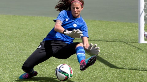 FILE - In this June 5, 2015, file photo, Canada's goalkeeper goalkeeper Stephanie Labbe makes a save during soccer practice in Edmonton, Alberta. Labbe wondered if people valued the bronze medal she won in soccer more than they valued her as an individual. She sank into depression. It wasn't the first time Labbe has wrestled with depression, and she says it likely won't be the last. But speaking out about it has become one of the most important aspects of her recovery. (Jason Franson/The Canadian Press via AP, File)