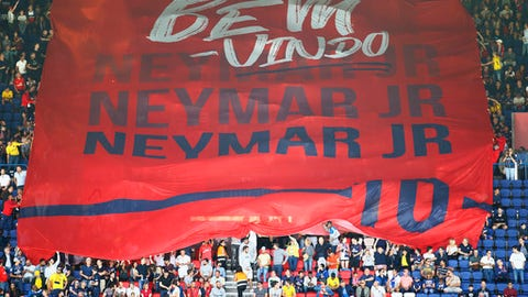 PSG fans welcome Brazilian soccer star Neymar at the Parc des Princes stadium in Paris, Saturday, Aug. 5, 2017, during his official presentation to fans ahead of Paris Saint-Germain's season opening match against Amiens. Neymar would not play in the club's season opener as the French football league did not receive the player's international transfer certificate before Friday's night deadline. The Brazil star became the most expensive player in soccer history after completing his blockbuster transfer from Barcelona for 222 million euros ($262 million) on Thursday. (AP Photo/Francois Mori)