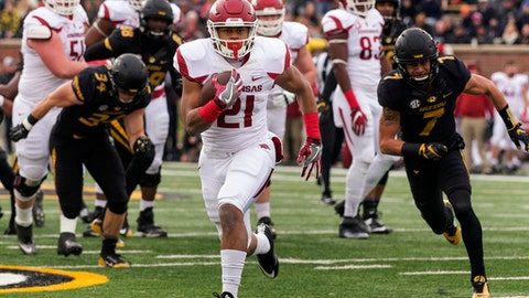 FILE - This Nov. 25, 2016 file photo shows Arkansas running back Devwah Whaley scoring on a 30-yard run during the first quarter of an NCAA college football game against Missouri in Columbia, Mo. Whaley was expected to once again serve in a backup role this season, a year after rushing for 602 yards as a freshman. However, with the career of Rawleigh Williams coming to an end after a second neck injury during the spring, the Razorbacks have turned to Whaley as their lead back entering the season. (AP Photo/L.G. Patterson, file)