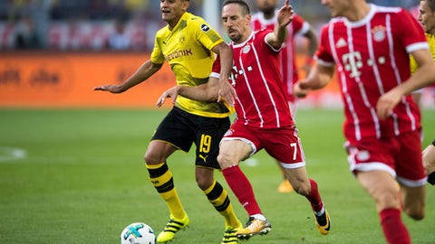 Dortmund's Mahmoud Dahoud, left, and Bayern's Frank Ribery vie for the ball during the Supercup soccer final between FC Bayern Munich and Borussia Dortmund in the Signal-Iduna-Park in Dortmund, Germany, Saturday, Aug. 5 2017. (Marius Becker/dpa via AP)