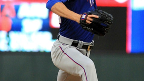 Texas Rangers pitcher Cole Hamels throws to a Minnesota Twins batter during the first inning of a baseball game Saturday, Aug. 5, 2017, in Minneapolis. (AP Photo/Andy Clayton-King)
