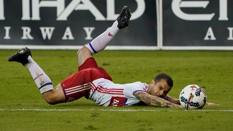 Toronto FC forward Sebastian Giovinco falls to the ground after losing control of the ball during the second half against D.C. United in an MLS soccer match, Saturday, Aug. 5, 2017, at RFK Stadium in Washington. The game ended in a 1-1 draw. (AP Photo/Pablo Martinez Monsivais)