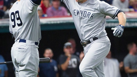 New York Yankees' Chase Headley celebrates after hitting a solo home run off Cleveland Indians relief pitcher Zach McAllister with New York Yankees' Aaron Judge during the eighth inning of a baseball game in Cleveland, on Saturday, Aug. 5, 2017. (AP Photo/Phil Long)
