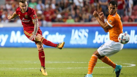 Real Salt Lake midfielder Kyle Beckerman, left, shoots past Houston Dynamo midfielder Juan David Cabezas (5) during an MLS soccer match at Rio Tinto Stadium in Sandy, Utah, Saturday, Aug. 5, 2017. (Spenser Heaps/The Deseret News via AP)