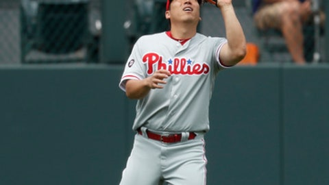 Philadelphia Phillies left fielder Hyun Soo Kim pulls in a fly ball off the bat of Colorado Rockies' Carlos Gonzalez in the first inning of a baseball game Sunday, Aug. 6, 2017, in Denver. (AP Photo/David Zalubowski)
