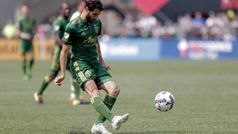 Portland Timbers' Diego Valeri (8) chips the ball through the Los Angeles Galaxy defense during an MLS soccer match in Portland, Ore., Sunday, Aug. 6, 2017. (Sean Meagher/The Oregonian via AP)