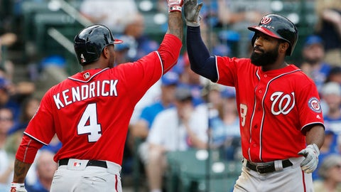 Washington Nationals' Brian Goodwin, right, celebrates with Howie Kendrick after hitting a solo home run against the Chicago Cubs during the ninth inning of a baseball game Sunday, Aug. 6, 2017, in Chicago. (AP Photo/Nam Y. Huh)