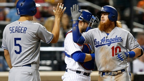 CORRECTS FROM SECOND INNING TO THIRD INNING - Los Angeles Dodgers' Corey Seager (5) greets Justin Turner (10) after scoring on Turner's third inning two-run home run in a baseball game against the New York Mets, Sunday, Aug. 6, 2017, in New York. (AP Photo/Kathy Willens)