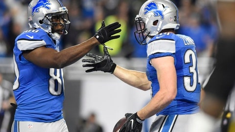 Detroit Lions fullback Zach Zenner, right, is congratulated by wide receiver Anquan Boldin after scoring a touchdown during the first half of an NFL football game against the Green Bay Packers, Sunday, Jan. 1, 2017, in Detroit. (AP Photo/Jose Juarez)